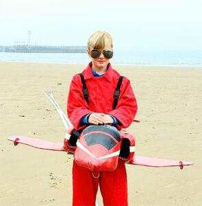 Boy wearing Red Arrows costume